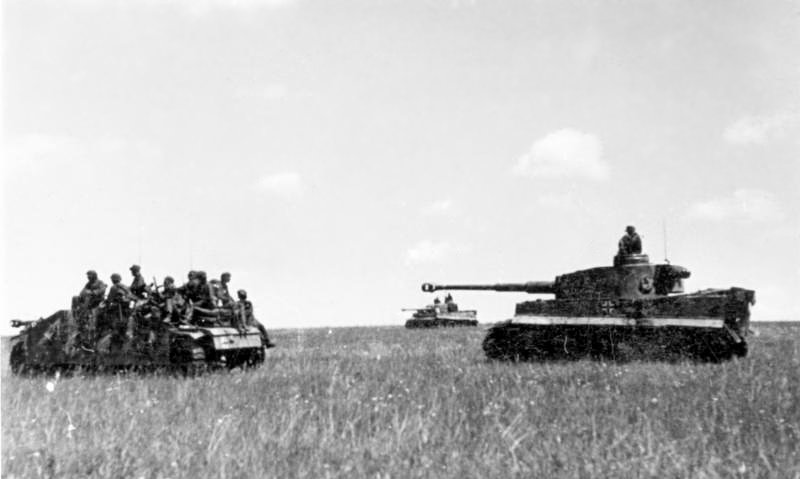 Two Tiger tanks and a StuG with infantry